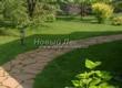 Садовая дорожка из плитняка (камень-пластушка, швы с травой) - 106