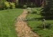Садовая дорожка из плитняка (камень-пластушка, швы с травой) - 114