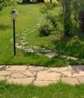 Садовая дорожка из плитняка (камень-пластушка, швы с травой) - 116