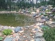 Строительство искусственного водоема и альпийской горки под ключ: весна вступила в свои права, ландшафтные дизайнеры продолжат оформление горки и берегов пруда декоративными растениями